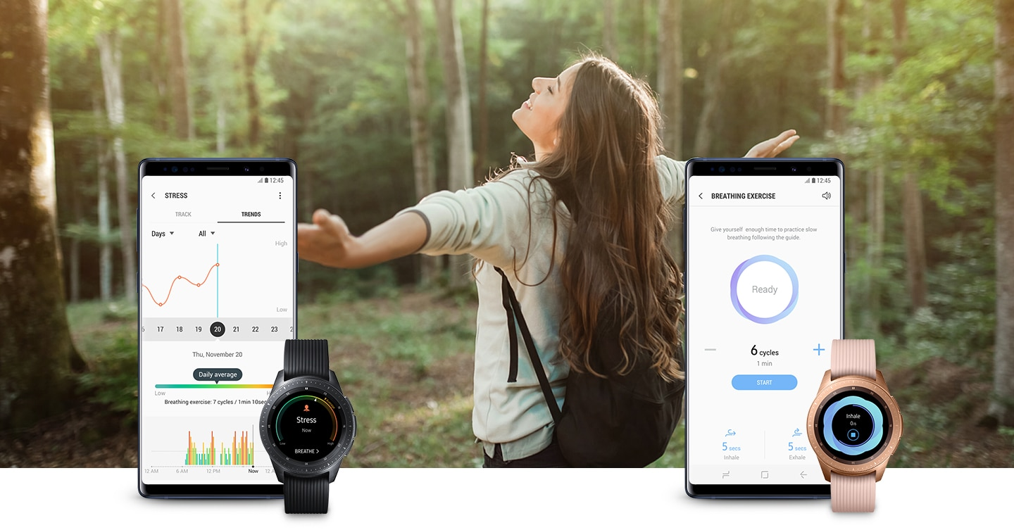 "A background of a woman in a forest with her arms open enjoying the fresh air. On the left, in the background, is a Galaxy Note9 Ocean Blue running ""STRESS"" in the Samsung Health app. In the foreground is a Black Galaxy Watch displaying ""Stress Always on"". On the right, in the background, is a Galaxy Note9 Ocean Blue running ""BREATHING EXERCISE"" in the Samsung Health app. In the foreground is a Rose Gold Galaxy Watch displaying ""Inhale""."
