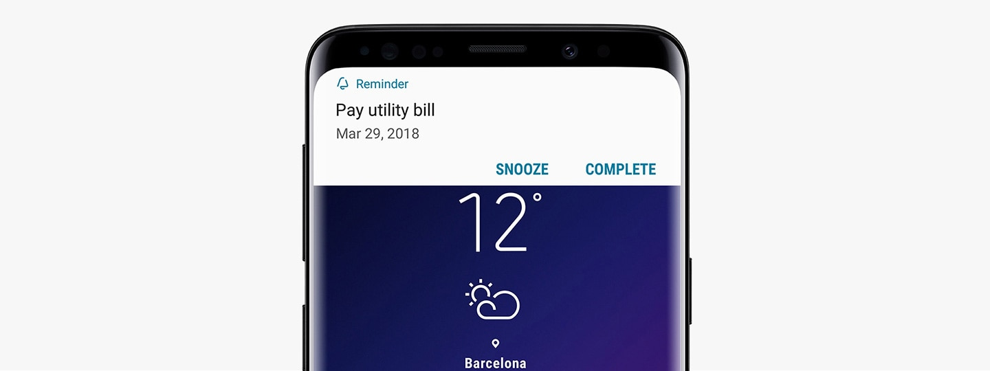 An image of Galaxy S9 Midnight Black receiving a 'Pay Utility bill' notification from Bixby Reminder.