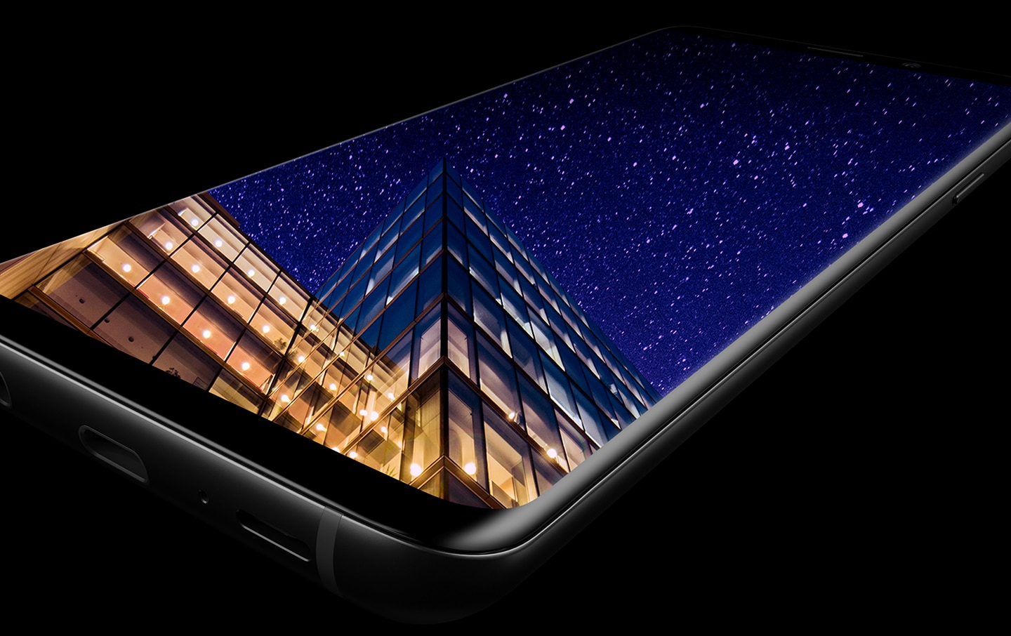 Galaxy S9 or S9+ laying flat to show the Infinity Display with an image on-screen