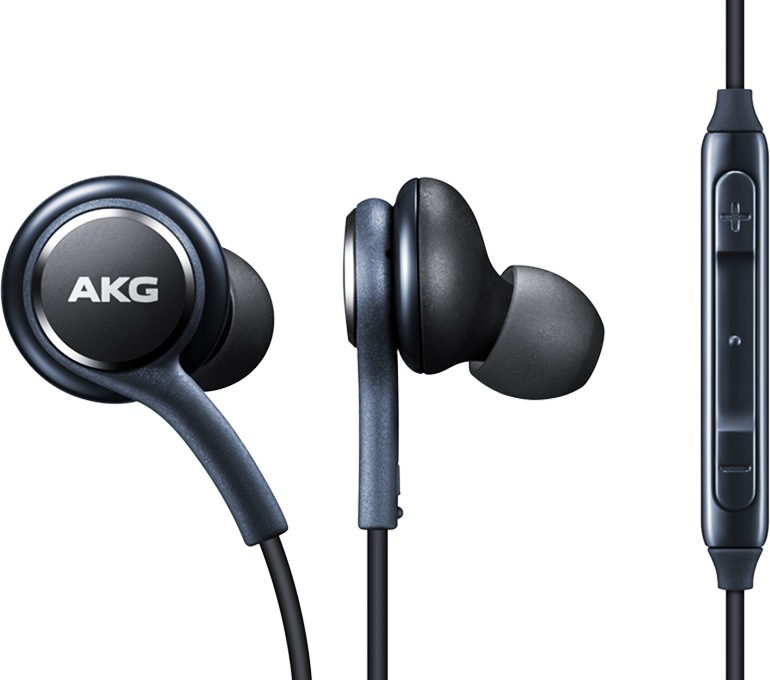 Close-up of earphones tuned by AKG showing earbuds and volume control
