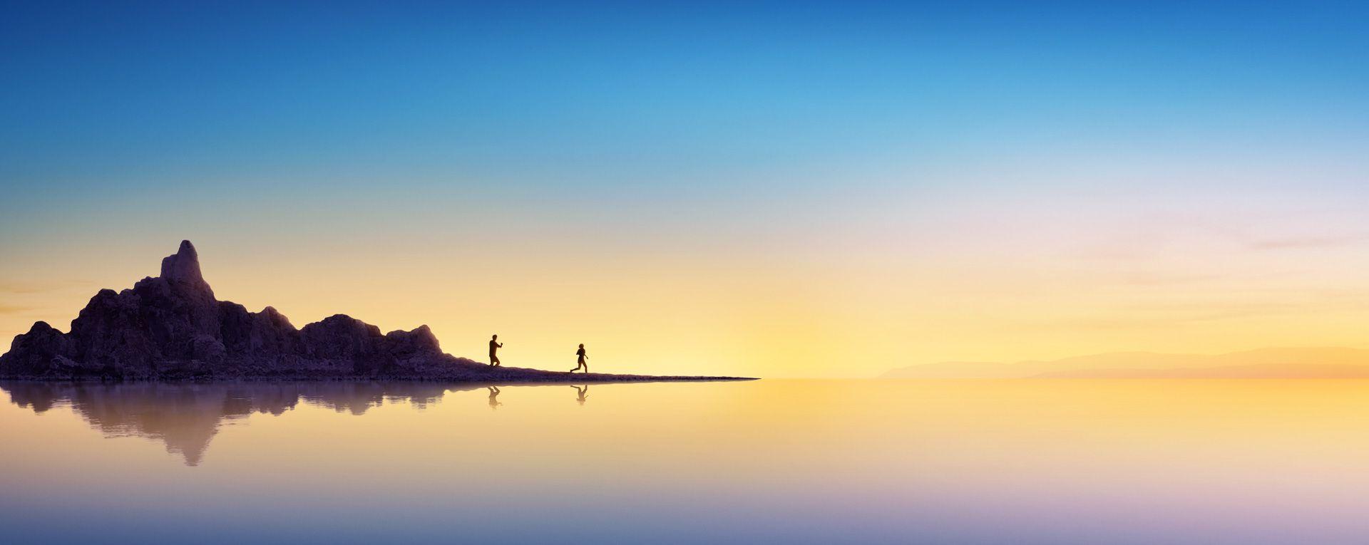 Imagen de un océano y una isla al amanecer
