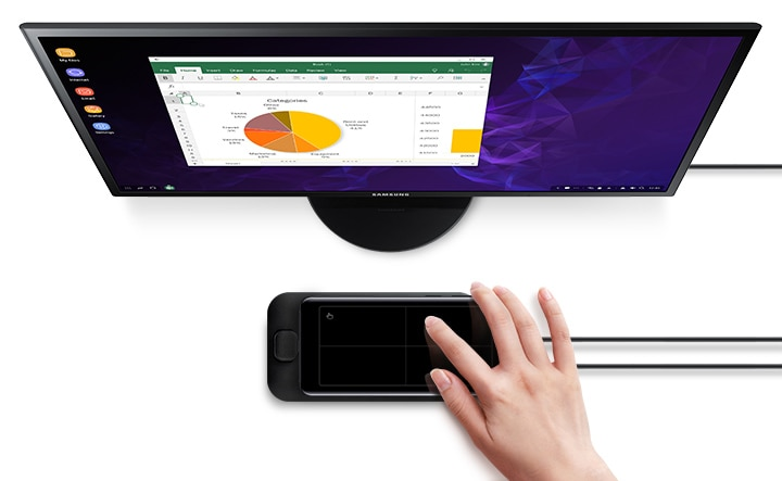 Galaxy S9 or S9+ with a spreadsheet on-screen sliding onto Samsung DeX Pad in front of a Samsung monitor